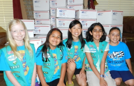 Girl Scouts Packing for our troops