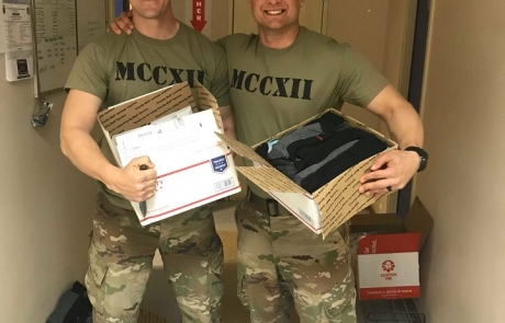 Troops Smiling for Packages
